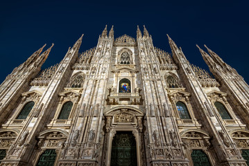 Wall Mural - Milan Cathedral or Duomo di Milano at night, Italy. It is a top tourist attraction of Milan. Majestic Gothic architecture of Milan in evening. Front view of the famous Milan landmark at dusk.