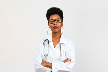 Portrait of Brazilian black woman doctor with stethoscope, white background