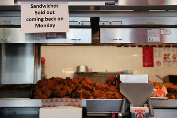 A sign posted inside Popeyes Louisiana Kitchen states that the restaurant is out of their new chicken sandwiches in the Queens borough of New York