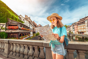 Fotobehang Nice Happy asian female tourist with map searching for travel location in European old town
