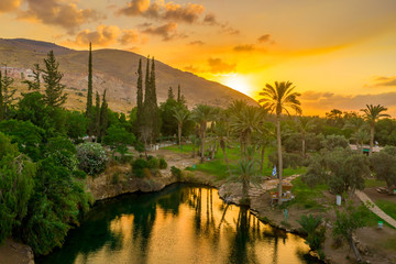 Garden Poster Honey Aerial view of the sunset over Sachne or Gan Hashlosha oasis, with popular waterfall in Northern Israel