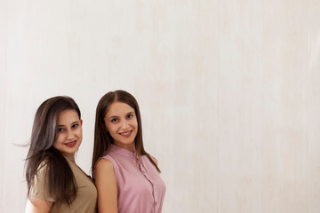 Two young middle-eastern girls. Portrait of two cheerful young women standing together. Sisters posing.