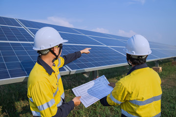 Engineering is checking the accuracy of the solar panel system installation, alternative electricity source, concept of sustainable resources Wall mural