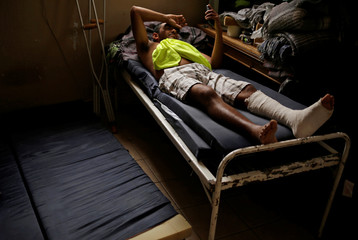 A migrant from El Salvador is seen at a migrant shelter after he sustained a fractured leg when falling from a wall between Ciudad Juarez and the United States border, in Ciudad Juarez