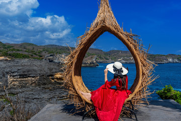 Canvas Print - Woman sitting on straw nests in Bali island, Indonesia.