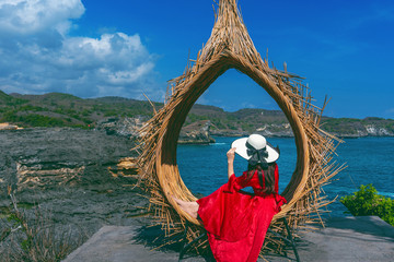 Wall Mural - Woman sitting on straw nests in Bali island, Indonesia.