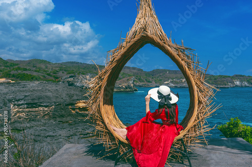 Wall mural Woman sitting on straw nests in Bali island, Indonesia.