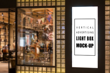 Mock up vertical light box on glass panel front of shop Wall mural