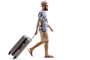 Bearded man with a suitcase walking