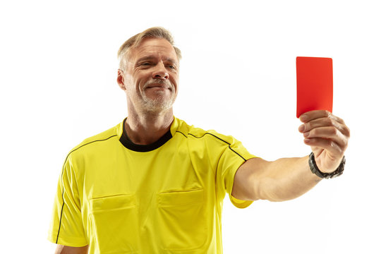 Referee showing a red card to a displeased football or soccer player while gaming isolated on white studio background. Concept of sport, rules violation, controversial issues, obstacles overcoming.