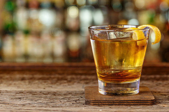 Cocktail with whiskey in a glass old fashion
