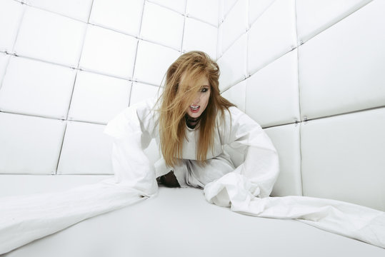 crazy girl dressed in a straitjacket