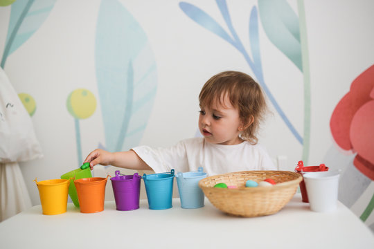 Learning colors, child play with colored wood toys