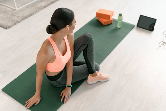 Young woman training with modern devices stock photo