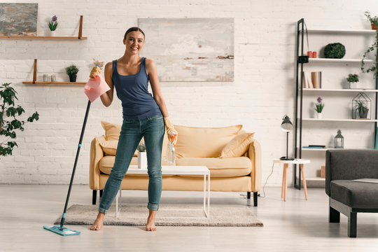 Young female having fun during household chores stock photo