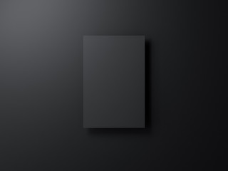 Black poster mockup hanging on black wall