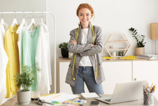 Talented young dressmaker posing in workshop, free space