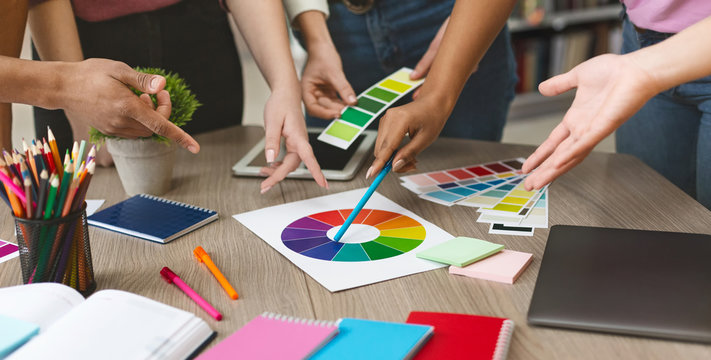 Group of graphic designers choosing color swatch samples