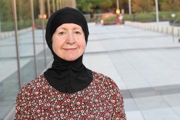 Senior Arabic woman in the city