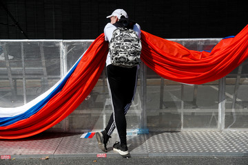 A man holds a part of a folded giant Russian national flag during the National Flag Day celebration in Moscow