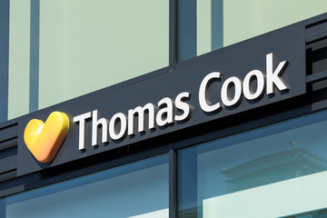 Stade, Germany - August 22, 2019: Signage identifying a Thomas Cook travel agencies branch