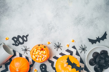 Halloween holiday background with pumpkin and candy corn .Top view from above. Flat lay