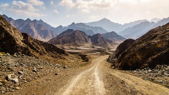 Dirt road in Hajar mountains in Dubai, UAE