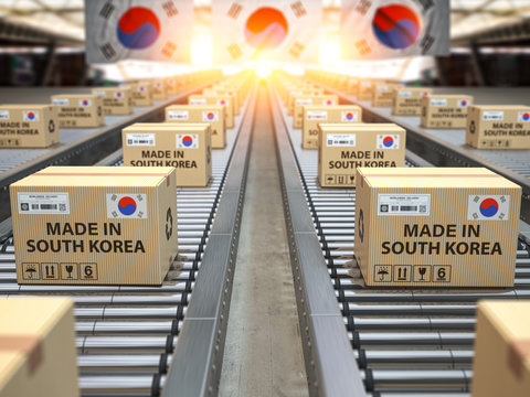 Made in South Korea. Cardboard boxes with text made in Korea and korean flag on the roller conveyor.