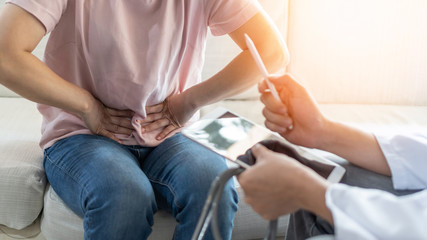 Abdominal pain patient woman having medical exam with doctor on illness from stomach cancer, irritable bowel syndrome, pelvic discomfort, Indigestion, Diarrhea, GERD (gastro-esophageal reflux disease)