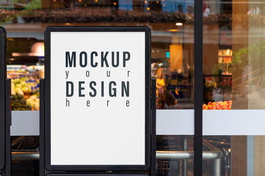 Mockup advertising board in front  of supermarket. Mock up billboard for your text messege or mock up content with department store or shopping mall background.