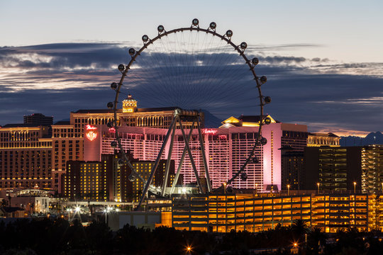 Editorial dusk view of the Flamingo Casino Resort and High Roller ferris wheel on November 28, 2013 in Las Vegas, Nevada, USA.