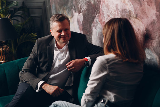 Portrait of a businessman talking with woman. Business and success concept.