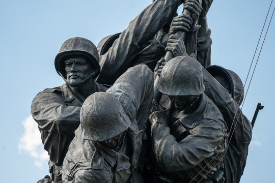 Arlington, Virginia - August 7, 2019: United States Marine Corp War memorial depicting flag planting on Iwo Jima in WWII (World War 2) - close up view of sculpture