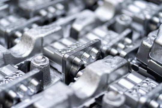 Pile of aluminum automotive parts, casting process in the automotive factory