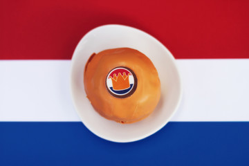 An orange Bossche bol pastry to celebrate King's Day