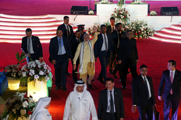 Indian Prime Minister Narendra Modi waves at the crowd after his speech during his two-day visit, at Bahrain National Stadium, Isa Town, in Manama