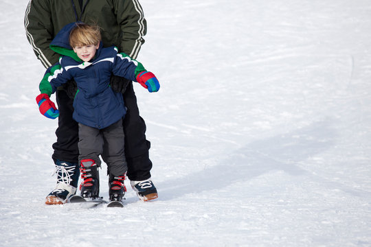 boy learning to ski
