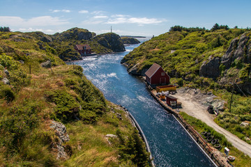 Canal between the islands in the beautiful old fishing village Rovaer in western Norway.