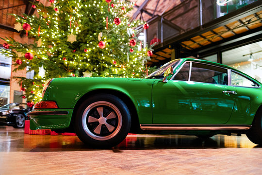 Green vintage classic car auto Berlin Christmas tree background