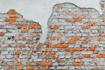 Urban brick wall cracked as background isolated