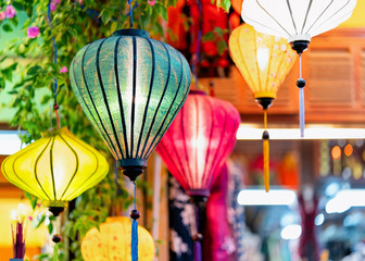 Colorful street lamps hanging at market in Hoi An