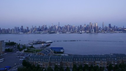 Fototapete - Timelipse of New york city skyline from New jersey, the end of the day and lights of the city