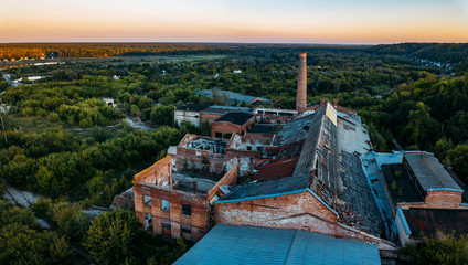 Ruined overgrown abandoned sugar factory in Ramon, aerial view