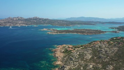 Wall Mural - View from above, stunning aerial view of the Maddalena Archipelago National Park with some islands surrounded by a beautiful turquoise clear sea, Caprera island in the distance. Sardinia, Italy.