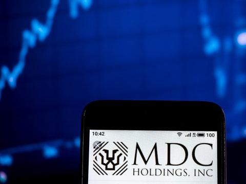 Kiev, Ukraine, February 2, 2019, illustrative editorial. MDC Holdings Company logo seen displayed on smart phone