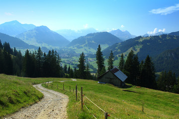 View from the mountains and hiking path near Saanen, Switzerland, in the direction of Gstaad.