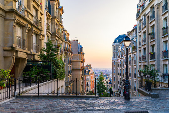 Montmartre district of Paris. Morning Montmartre staircase in Paris, France. Europa. View of cozy street in quarter Montmartre in Paris, France. Architecture and landmarks of Paris. Postcard of Paris.