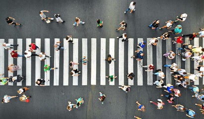 Aerial. People crowd motion on pedestrian crosswalk. Top view from drone. Fototapete