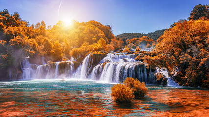 Krka national park with autumn colors of trees, famous travel destination in Dalmatia of Croatia. Krka waterfalls in the Krka National Park in autumn, Croatia.
