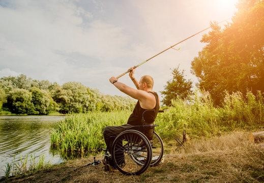 Handicapped man fishing at a lake. Wheelchair. Camping.